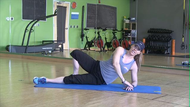 Catherine Andersen, head coach and owner for Achieve Personal Fitness and Milwaukee Adventure Boot Camp at Balance Fitness in Whitefish Bay, shows exercise to target your love handles and muffin top.