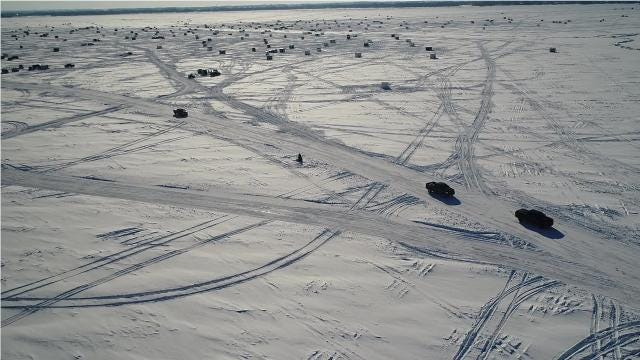 A network of 75 miles of roads on Lake Winnebago ice provides access to fishing shacks and for some folks a speedier route to work.
