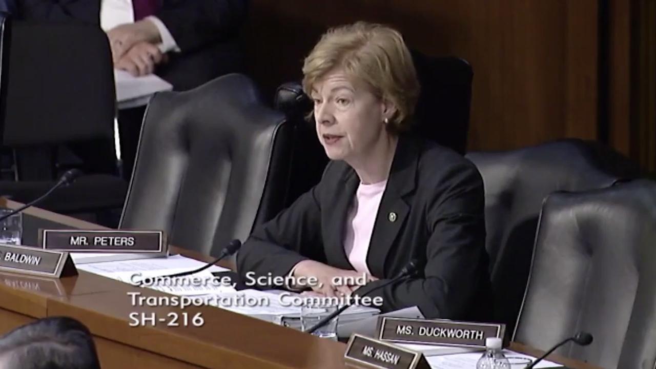 Tammy Baldwin at Senate hearing asking about travel websites