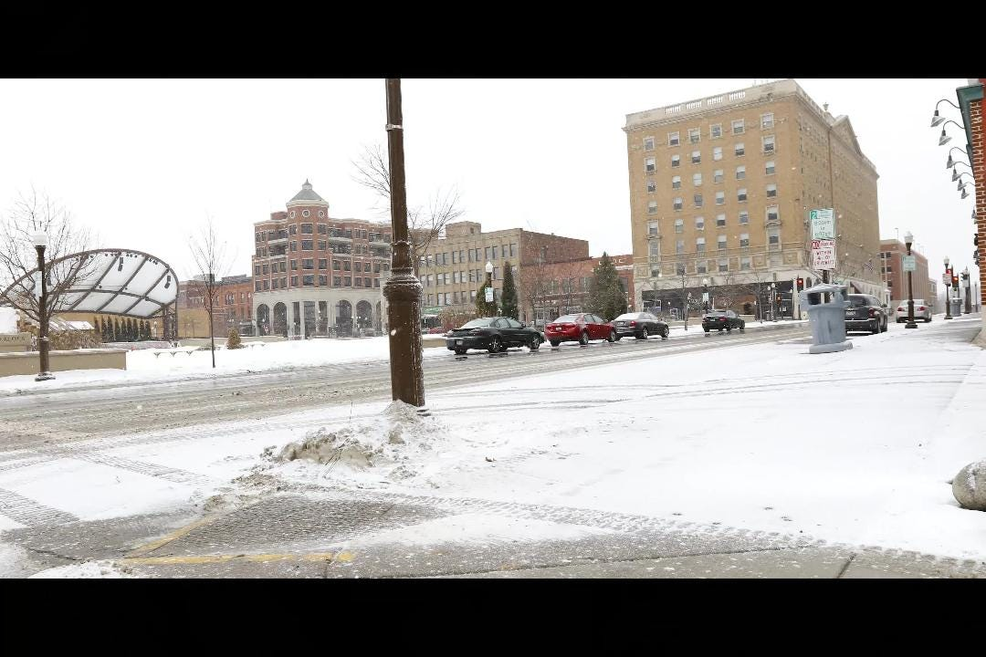 Snowfall Monday afternoon in downtown Wausau.