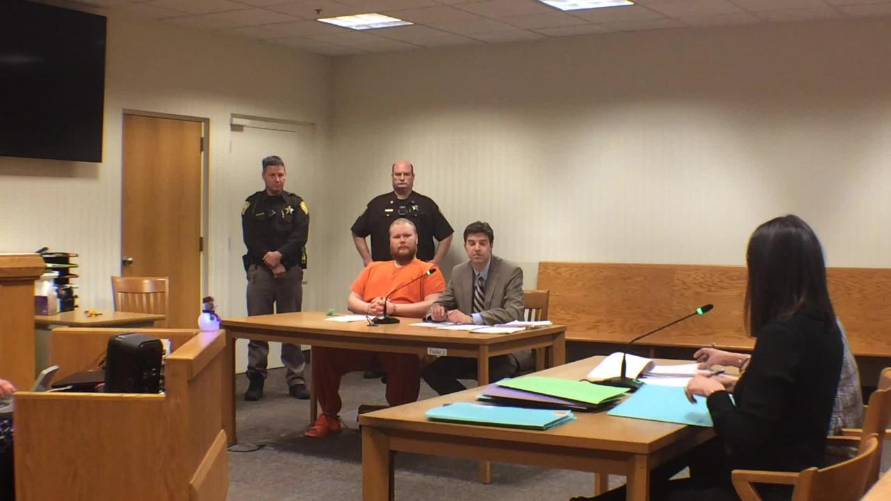 "David Etheridge, 23, made his initial appearance Monday in Outagamie County court after his weekend arrest. Police say he sent a message to the FBI threatening to ""shoot up the school,"" though no specific school was named."