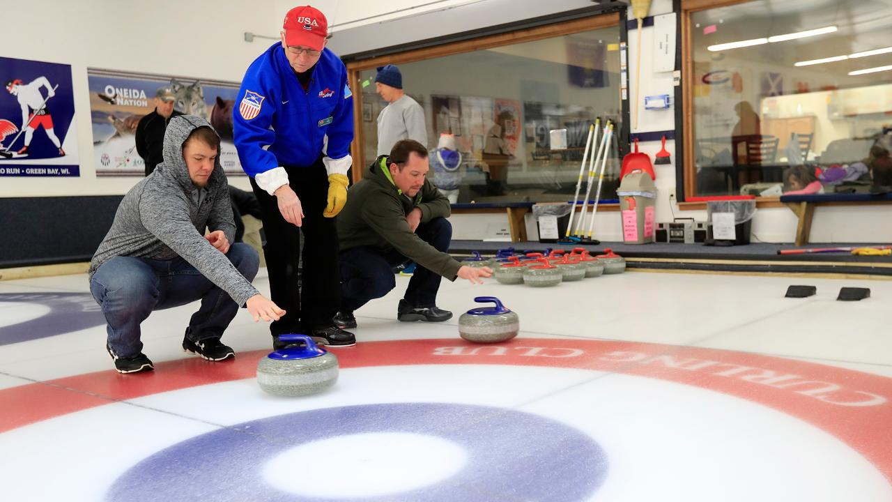 Newcomers to the sport of curling try their hands at the sport in a curling class at the Green Bay Curling Club on Feb. 23, 2018.