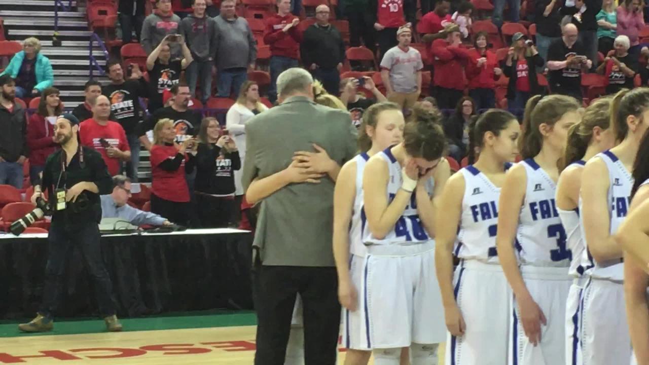 Amherst girls basketball coach Gregg Jensen and senior Heather Pearson share a hug following their WIAA state girls basketball Division 3 state championship loss at the Resch Center in Ashwaubenon.