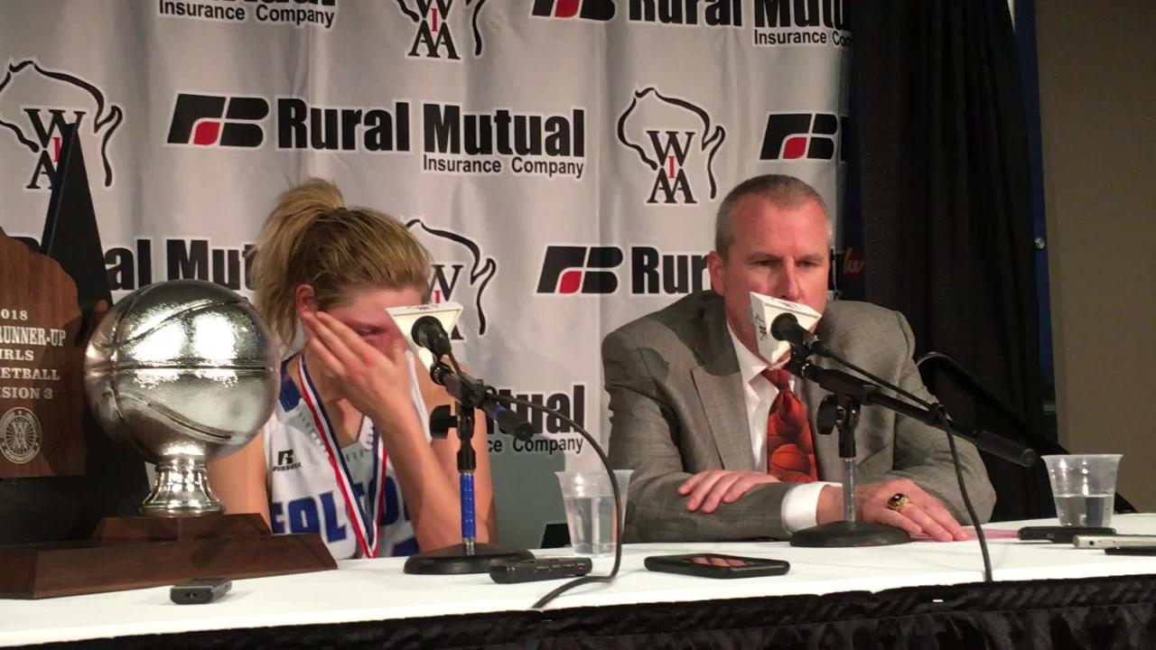 Amherst girls basketball coach Gregg Jensen talks about what he told his senior center, Heather Pearson, after the state championship game.