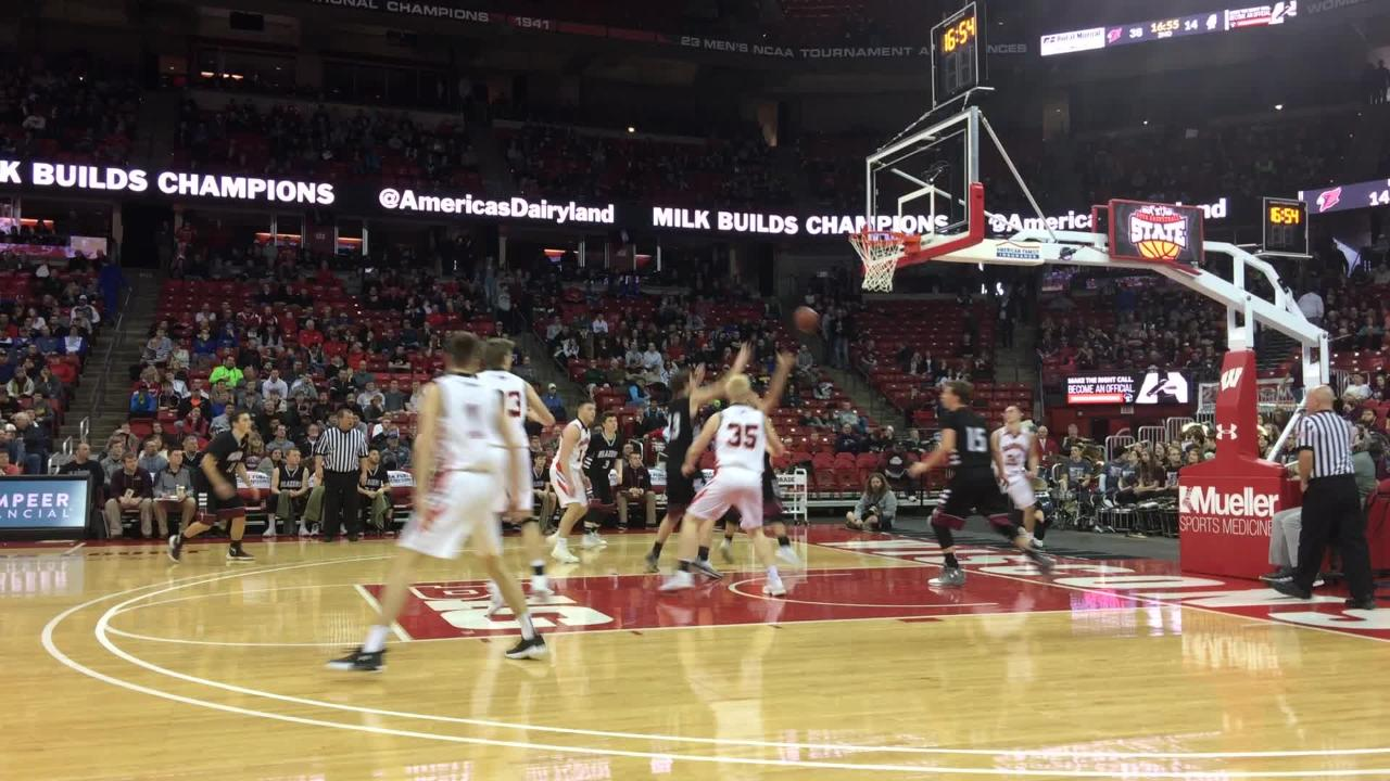 N.E.W. Lutheran's Chip Kindt scores on a layup during Friday's WIAA Division 5 boys state basketball semifinal game against Bangor at the Kohl Center in Madison.