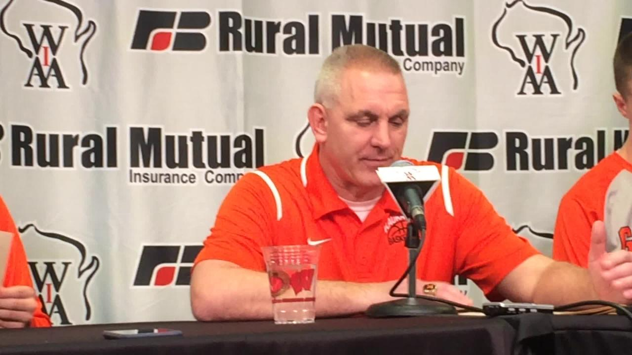 Kaukauna boys basketball coach Mike Schalow looks back on Friday's WIAA Division 2 state semifinal victory over Westosha Central at the Kohl Center in Madison.