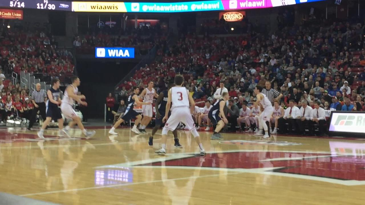 Mitchel Schneider and Chombi Lambert combine to give Roncalli a quick burst of offense in the Division 4 state title game Saturday at the Kohl Center in Madison.