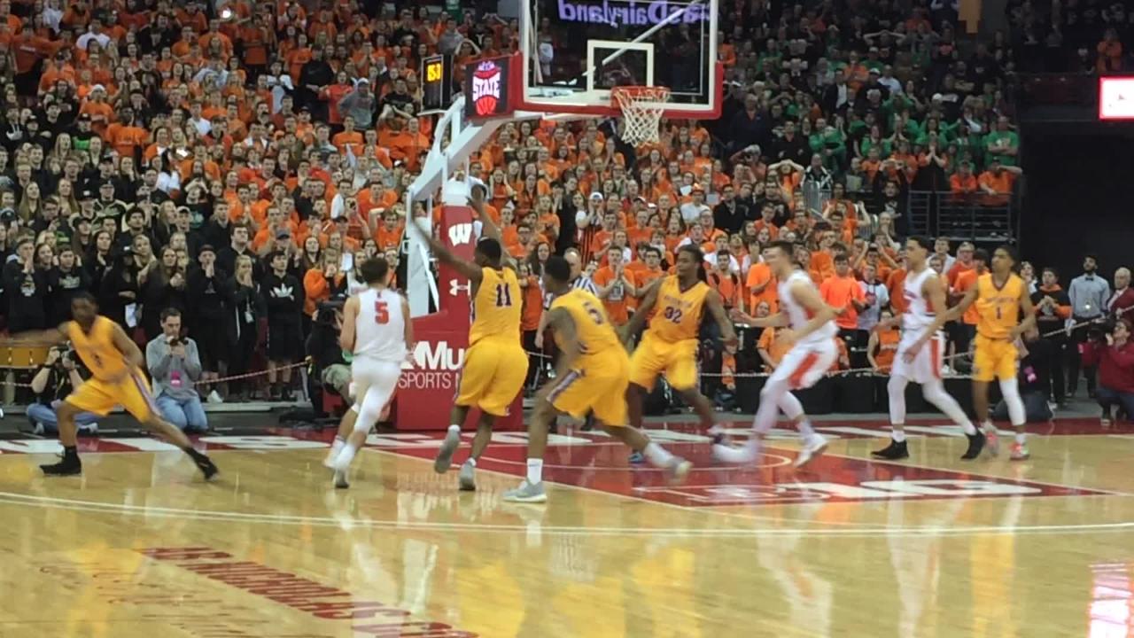 Jordan McCabe drives for the winning basket for Kaukauna