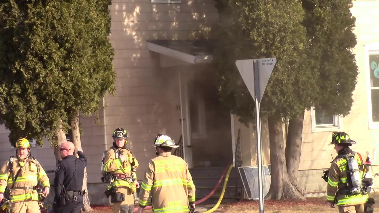 The fire was contained to a kitchen in a multi family house.