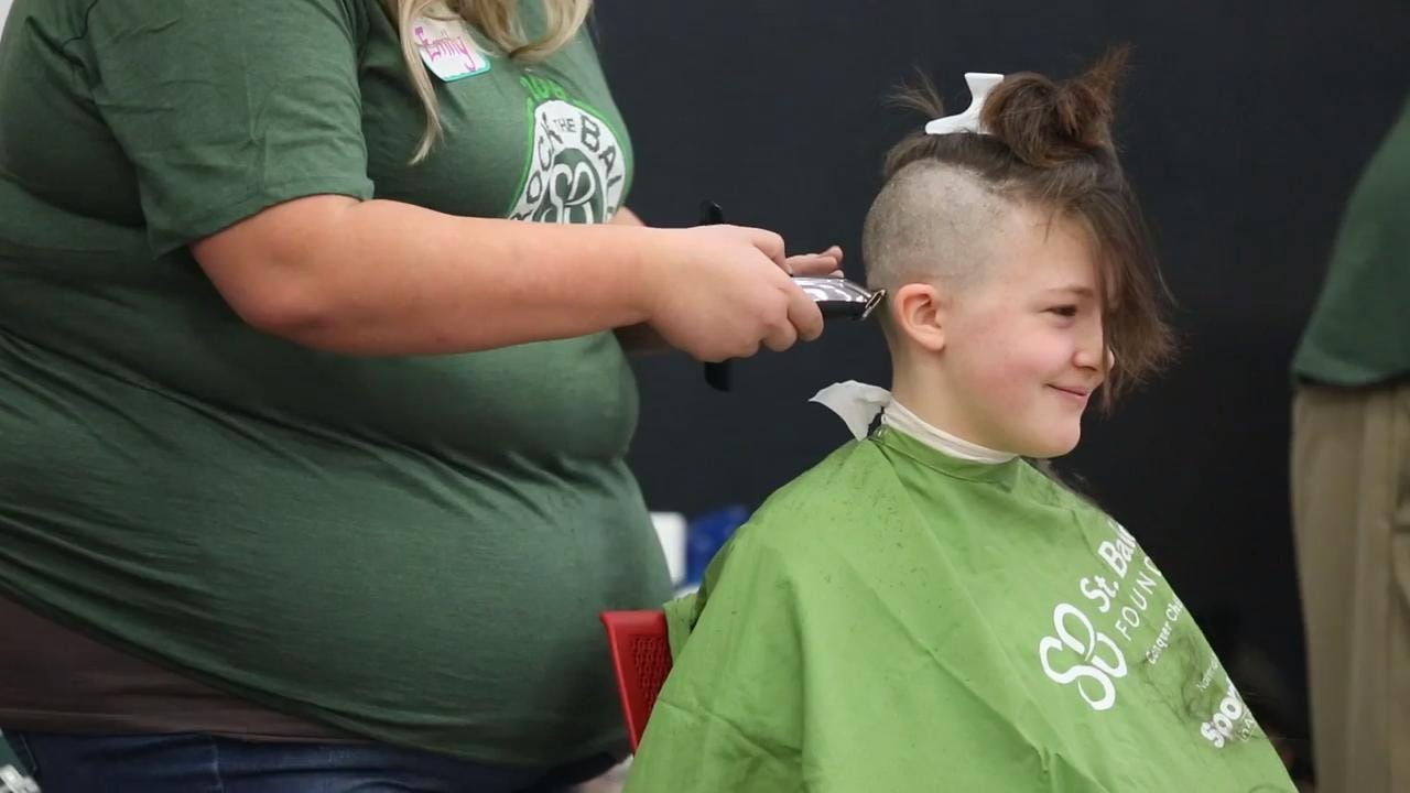 The 10th annual head-shaving event raises money for childhood cancer research.