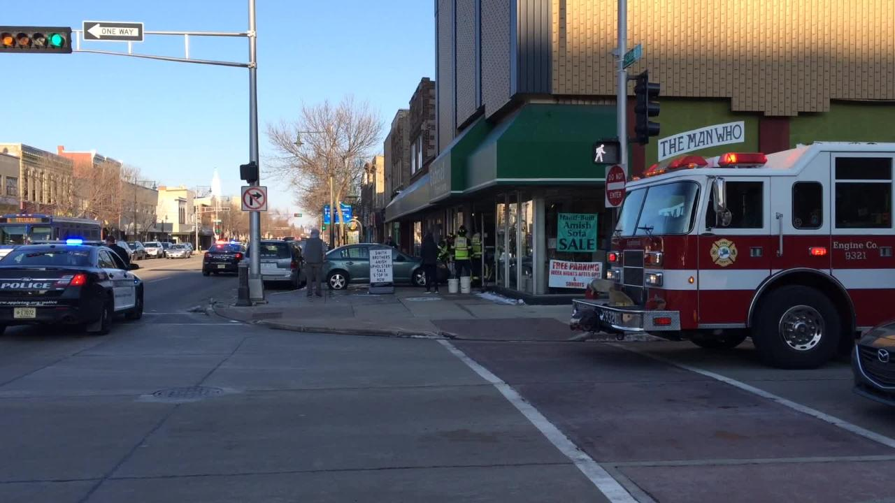 Firefighters and police responded when a car crashed through the front of Gabriel Furniture on College Avenue in Appleton late Thursday afternoon.