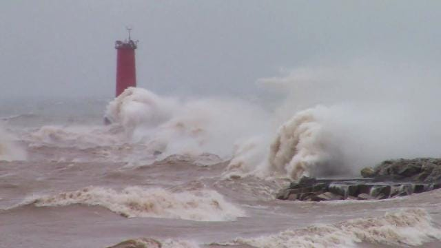 Large wind driven waves crash along the lakeshore of Sheboygan Saturday, April 14, 2018 as a powerful storm system moves through the area.