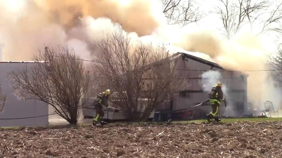 Fire fighters from multiple departments battled a morning garage fire on State Highway 23 in Fond du Lac County.