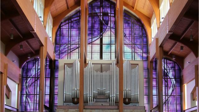 Elizabeth Devereaux of Chico, California designed Holy Family Church's 1,200-square-foot windows, working on the project since 2005.