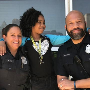 An 8-year-old girl has a big mission: Hugging cops in all 50 states