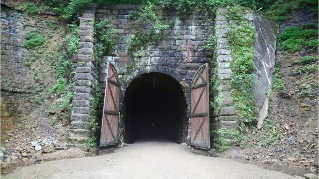 The country's first rail-trail features three historic railroad tunnels.