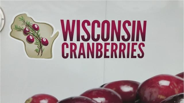 Visitors could stand in a flooded cranberry bog, taste delicious samples, make a bog in a cup, and learn interesting facts about Wisconsin's number one fruit.