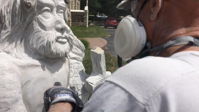 Noted local sculptor Jeff Olson creates a monument dedicated to St. John the Baptist at Stella Maris Catholic Parish in Egg Harbor. He will sculpt statues at all five Stella Maris churches in Door County this summer.
