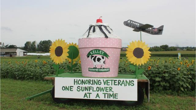 Tim and Karen Kelley planted an acre of sunflower on their family farm and creamery outside of Fond du Lac in hopes of raising donations to help veterans board an Old Glory Honor Flight to visit memorials erected in honor of their service and dedication.