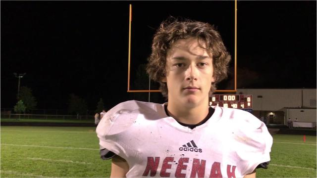 Safety turned quarterback Luke Elkin accounted for four touchdowns in Neenah's 33-0 win over Wisconsin Rapids on Thursday night in a fill-in role for regular starting quarterback Sam Dietrich.