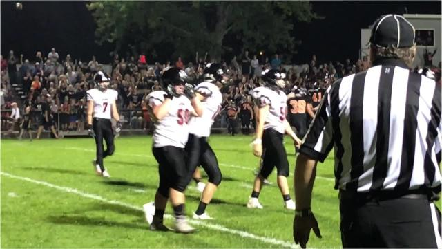 Marshfield players celebrate and SPASH players are dejected after the Tigers capped off a goal line stand in the closing seconds to prevent the Panthers from scoring the winning touchdown to preserve a 13-7 win Friday night.