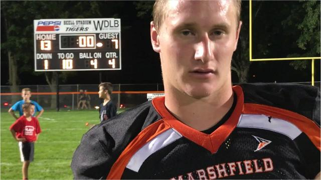 Marshfield senior quarterback Ryan Krueger passed and a touchdown and ran for another score as the Tigers improved to 5-0 with a 13-7 win over SPASH at Beell Stadium on Friday night.