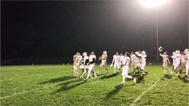 Almond-Bancroft football players celebrate the program's first Central Wisconsin Conference-Small championship since 2015 with a post-game shower for head coach Andrew Bradley