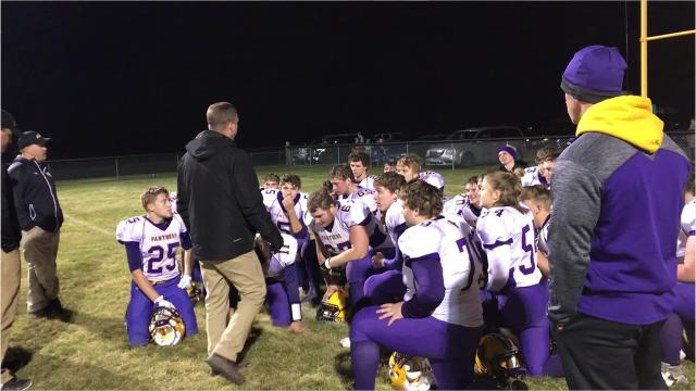 Pittsville coach Mark Denniston addresses his players after a 17-7 win over Almond-Bancroft in a Division 7 second round contest between CWC-Small rivals Friday night.