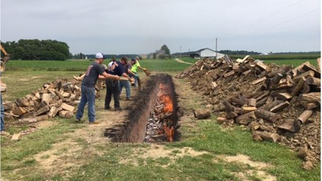 The Shiloh Firemen's Ox Roast is Friday and Saturday in the village along Main Street. The fire pit is tended to by firefighters Thursday in preparation for the sale of 8,500 pounds of beef, as in roast beef sandwiches which are popular the festival.