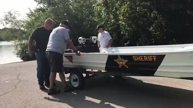 Authorities search lake for missing woman