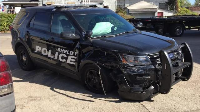 A Shelby police officer was involved in a crash with a van Monday afternoon.