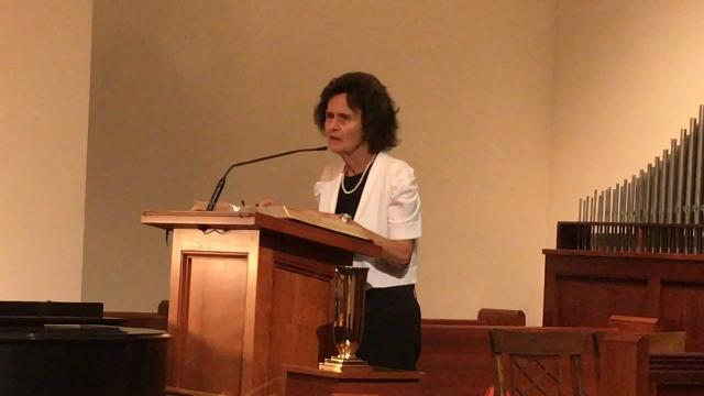 Sharon Sutton speaks on the world at large during a prayer service held at the Coshocton Presbyterian Church for the victims, family and friends of those impacted by recent national disasters and tragedies.