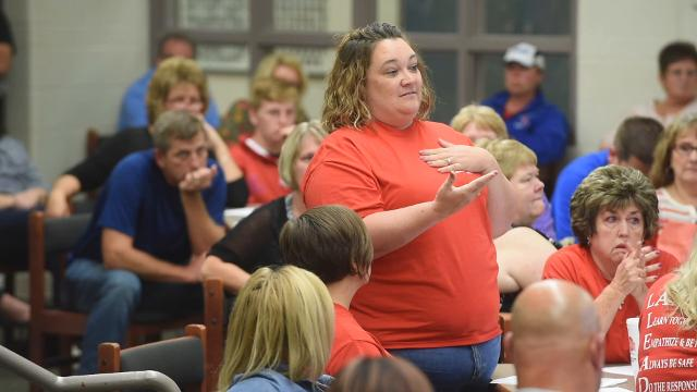 A rancorous Lakewood school board meeting Tuesday, which included the censuring of a board member and calls for another to resign, ended with a decision to delay a contract extension for Superintendent Mary Kay Andrews.