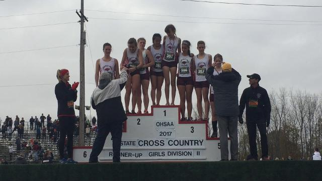 The Fairfield Union girls cross country team receiving their Division II state runner-under medals and trophy.