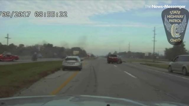 Trooper saves man from burning vehicle
