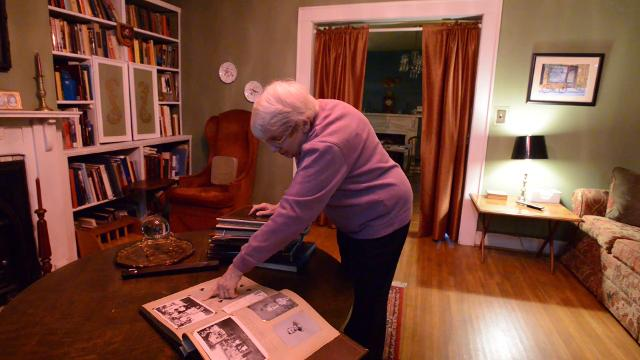 Carol Higgins, of Circleville, Ohio, received photo albums found in Oregon. Higgins had seen the albums which belonged to her now deceased parents for more than 25 years.