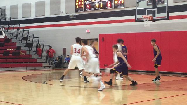 Fairfield Union's Colin Woodside scores two of his 24 points against Bloom-Carroll.