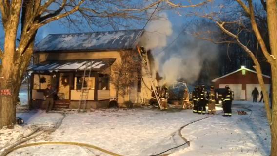 Firefighters battle a fire at 825 Marion Avenue Road North, on Wednesday, Dec. 13, 2017