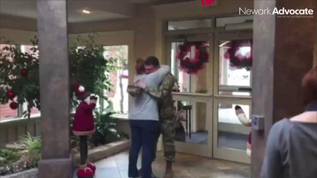 Colton Alexander surprises his mom, Lawanda, Friday morning at the Inn at Chapel Grove in Heath. Alexander is stationed in Nebraska as part of the Army National Guard and had not seen his mom for several months.