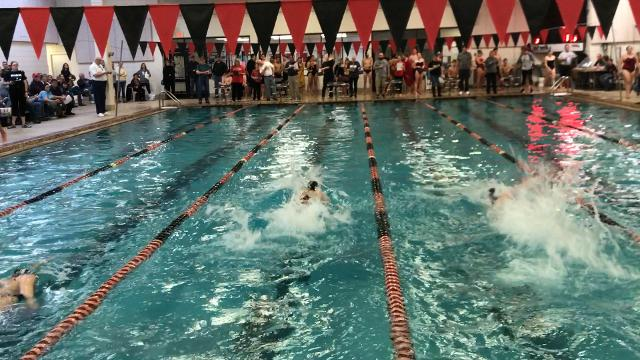 Newark's Madi Cartnal edges Granville's Brennah White to win the 50 freestyle Saturday at the Licking County Family YMCA.