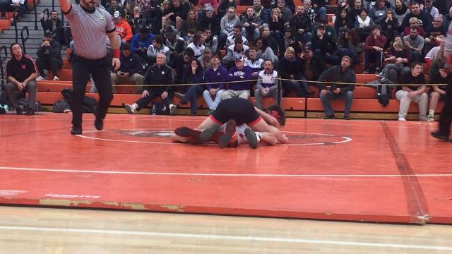 Crestview's Clay Eagle finishes a 15-0 technical fall for the 120 title in the 56th J.C. Gorman Invitational.