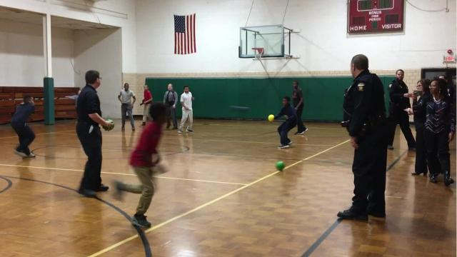 """Children and officers with the Mansfield Police Department, Ontario Police Department and Ohio Highway Patrol gathered at the Friendly House on Thursday afternoon for a friendly game of """"Cops and Kids"""" dodgeball."""