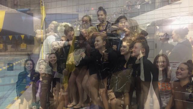 Lexington girls and boys make school history by sweeping the Ohio Cardinal Conference swim meet at Wooster.