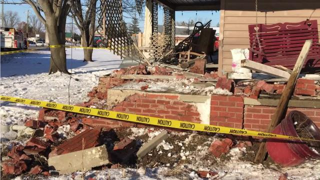 A tractor-trailer pushed a flatbed truck into a residence Thursday afternoon, destroying part of the home's front porch but not causing any injuries.