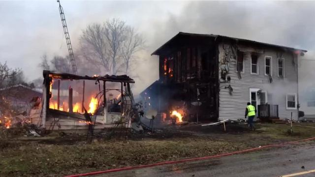 A woman who fell asleep smoking a cigarette and the wind are believed to be the causes of two house fires Jan. 23 near the intersection of North Liberty and Mishey roads in northern Knox County, south of Butler.