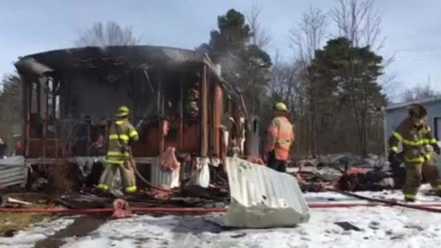 Mansfield firefighters battled a trailer fire Tuesday morning at Winners Circle North. The  residents were able to get out but a cat died in the blaze.