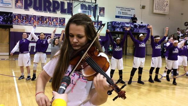 Fremont Ross senior Sarah Schott plays the national anthem on violin before the girls basketball game.