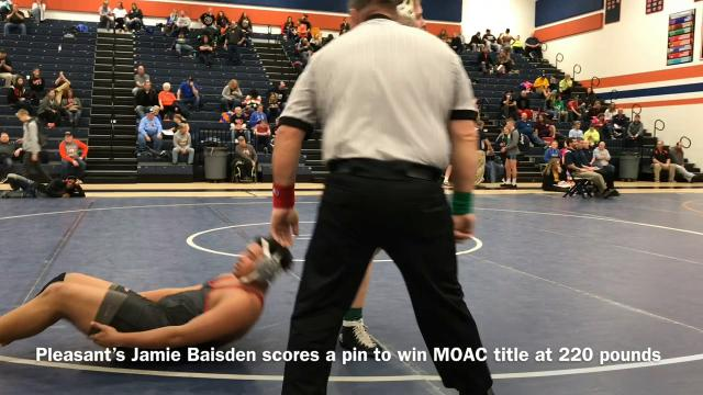 Pleasant senior wrestler Jamie Baisden pins Ethan Ashman of Harding in 1:19 in the championship bout for 220 pounds Saturday at Galion during the Mid Ohio Athletic Conference Wrestling Tournament.