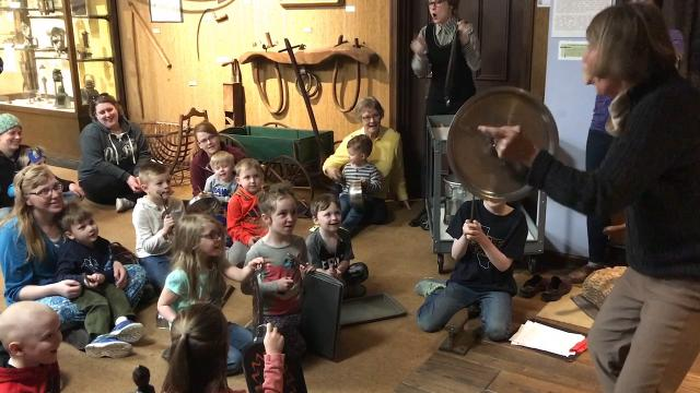 "Kids pound out the tune ""Jingle Bells"" with Patte Malenke, Director of the Johnson-Humrickhouse Museum leading the way. The museum's current program for preschool students focuses on metal, clay, glass and wood and creative materials."