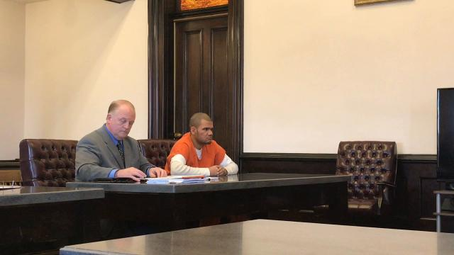 Attorney Jeff Mullen with client Reggie S. Taylor Friday in Coshocton Common Pleas Court being addressed by Judge Robert Batchelor. Taylor received three years in prison for the first-degree felony charge of aggravated burglary.